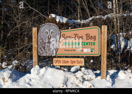 A Great-grey Owl decorates the sign to the Sax-Zim Bog, a natural bog and forest in northern Minnesota. Duluth, Minnesota, USA. - Stock Image