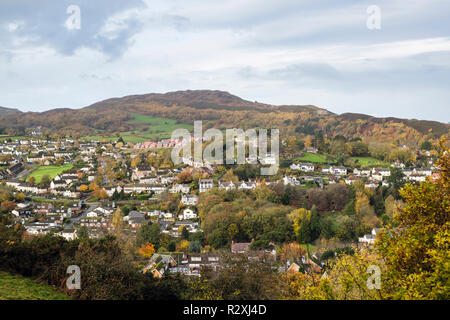 High view through trees over town below Conwy mountain hill in autumn. Conwy, Conwy county, Wales, UK, Britain - Stock Image