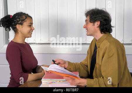 multicultural girl student having consultation with teacher - Stock Image
