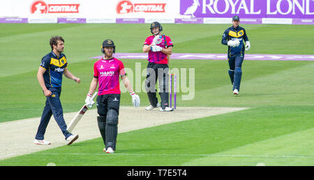 Brighton, UK. 7th May 2019 - Luke Wright of Sussex Sharks is dismissed for 97 runs off the bowling of Glamorgan's Lukas Carey (left) during the Royal London One-Day Cup match between Sussex Sharks and Glamorgan at the 1st Central County ground in Hove. Credit : Simon Dack / Alamy Live News - Stock Image