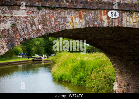 Detail of Bridge 54 with a lock in the distance on the Tardebigge Locks, Worcestershire - Stock Image