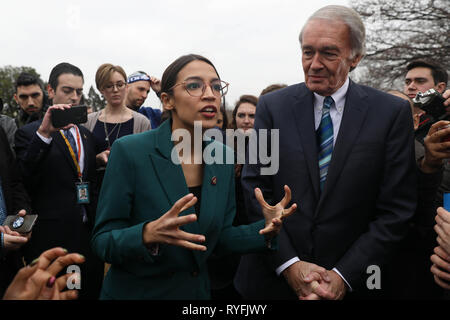 U.S. Rep. Alexandria Ocasio-Cortez, and Senator Ed Markey answers questions during the announcement for the Green New Deal legislation during a press conference outside the Capitol Building February 7, 2019 in Washington, D.C. - Stock Image