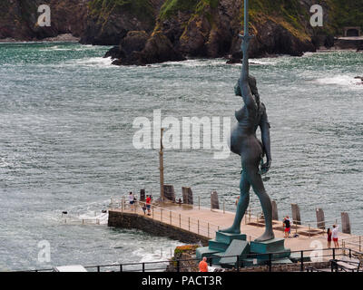 Damian Hirst sculpture 'Verity' dominates the harbour wall at Ilfracombe, North Devon, UK - Stock Image