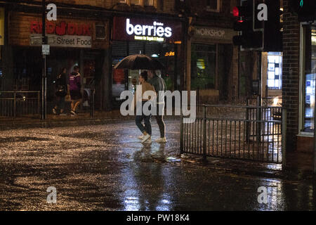 LEEDS, UK - 11 October 2018.  Short, but very sharp, rain showers caught people by surprise in Leeds this evening as dry conditions very quickly gave way to torrential rain showers. Credit: James Copeland/Alamy Live News - Stock Image