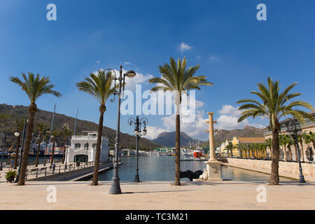 Cartagena Murcia Spain view of the port with palm trees and art sculpture of whale tail Cola de ballena - Stock Image