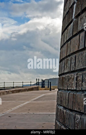 The imposing cast concrete sea wall towering over the Holbeck slipway in Scarborough's South Bay. - Stock Image