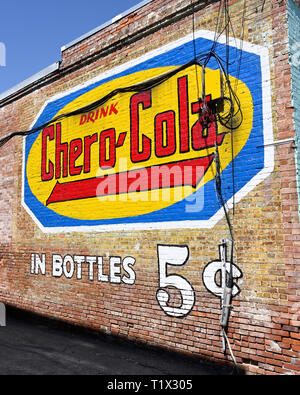 Outdoor advertising or marketing with bright color painting on a building wall for Chero-Cola in Alexander City Alabama, USA. - Stock Image