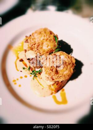 Deep fried eggs Benedict - Stock Image