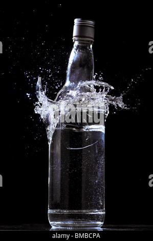 Full bottle breaking - Stock Image