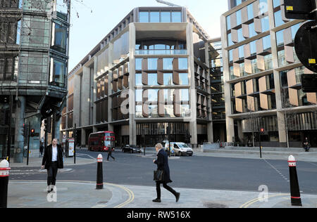 Street view of woman walking near the Bloomberg Building offices on Queen Victoria Street in the City of London England UK    KATHY DEWITT - Stock Image