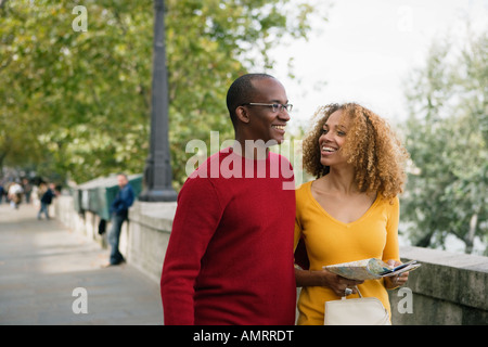 African couple walking - Stock Image