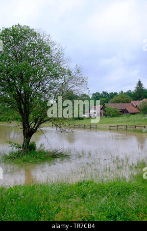 small river overflows after a period of prolonged heavy rain flooding the surrounding fields and meadows zala county hungary - Stock Image