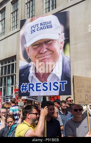 London, England, UK. 13 July, 2018.  Protestors in London marching against Donald Trump's visit to the UK © Benjamin John/ Alamy Live News. - Stock Image