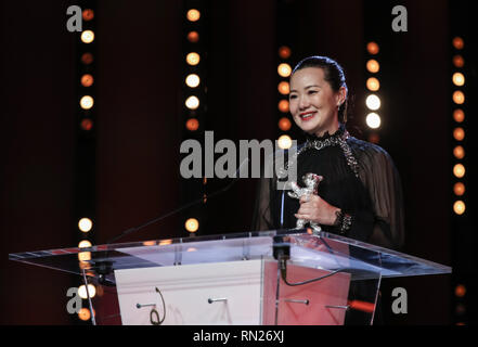 Berlin, Germany. 16th Feb, 2019. Chinese actress Yong Mei delivers a speech after receiving the Silver Bear for Best Actress during the award ceremony of the 69th Berlin International Film Festival in Berlin, capital of Germany, Feb. 16, 2019. Chinese actor Wang Jingchun and actress Yong Mei won the Silver Bears for Best Actor and Best Actress for their performances in the film 'So Long, My Son' at the 69th Berlin International Film Festival (Berlinale) on Saturday. Credit: Shan Yuqi/Xinhua/Alamy Live News - Stock Image