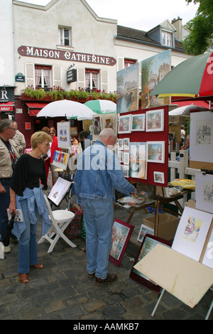 Paintings for sale in the artists quarter of place du tetre Montmartre Paris France Europe - Stock Image