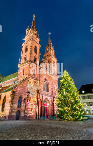 Basel, Switzerland. Christmas fairytale market at Munsterplatz and Munster Cathedral, Swiss Confederation. - Stock Image