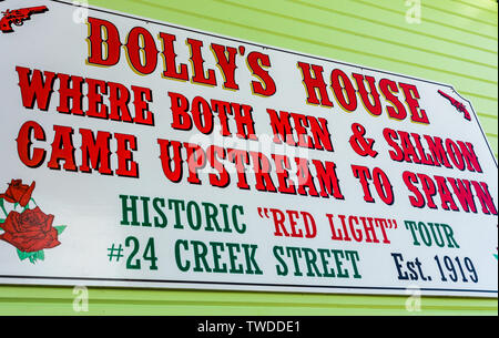 Sept. 17, 2018 - Ketchikan, AK: Sign on side of historic former brothel turned museum 'Dolly's House' on popular Creek Street. - Stock Image