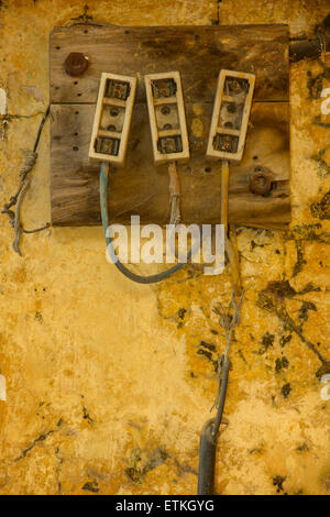 Indian electricity junction boxes on a wall. Jaipur, Rajasthan, India - Stock Image