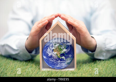 Protect the Earth, our home. Earth photo provided by Nasa. - Stock Image