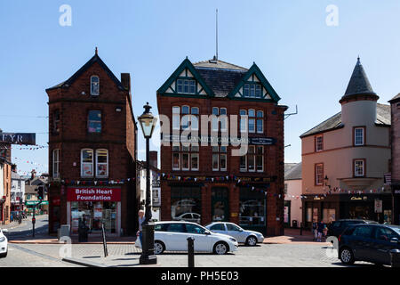 Town Centre Shops, Penrith, Cumbria, UK, England, Red Stone buildings - Stock Image