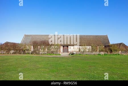A view of the fully restored Elizabethan Great Barn on the Norfolk coast at Waxham, Norfolk, England, United Kingdom, Europe. - Stock Image