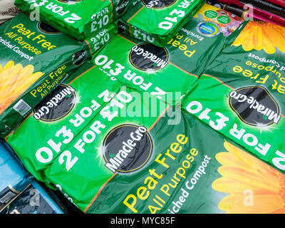 A stack of bags of Miracle-Gro peat free all-purpose enriched compost in a garden centre - Stock Image