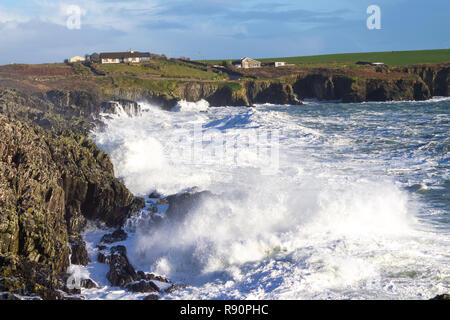 storm waves breaking against a cliff, west cork, ireland - Stock Image