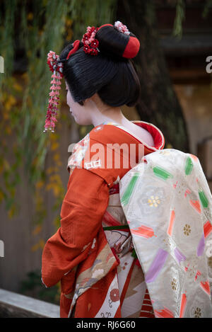 A Japanese girl that has had a geisha makeover, Kyoto, Japan. - Stock Image