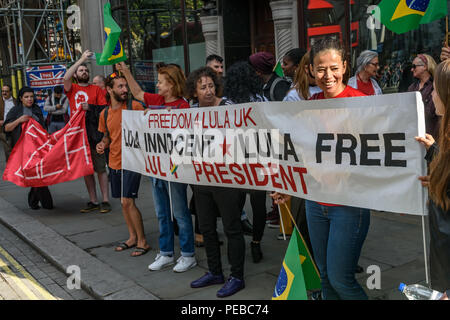 London, UK. 13th August 2018.  Brazilians hold a banner at the protest outside the Brazilian embassy calling for the release of Luiz Inacio Lula da Silva, a former trade union leader who was President of Brazil from 2003-11 to enable him to stand for election again in October. Credit: Peter Marshall/Alamy Live News - Stock Image