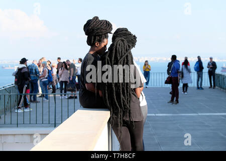 Group of girls young black women with African hairstyles hair extensions together in the Alfama district of Lisbon Portugal Europe EU  KATHY DEWITT - Stock Image