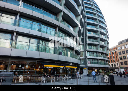 Modern architecture featuring a curved design on an office building at Te Silicon Roundabout, Old Street, London. - Stock Image