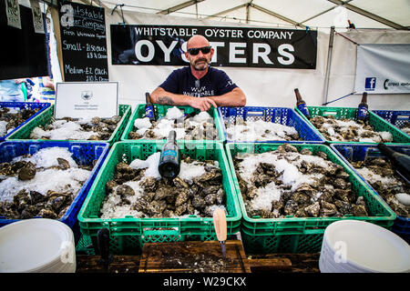 90th Kent County Show, Detling, 6th July 2019. The manager from The Whitstable Oyster Fishery Company displays his produce. - Stock Image