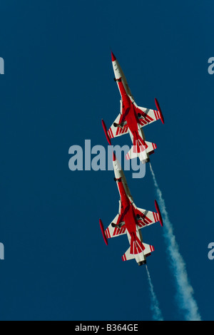 Two Canadair NF-5B aircraft of 'Turkish stars' aerobatic group Turkish Air Force during Air show in Kecskemét - Stock Image