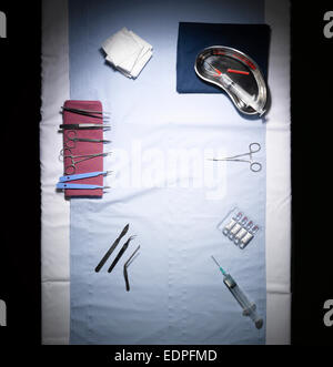 An overhead shot of an operating table with instruments - Stock Image