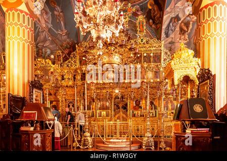 The ornate interior altar of the monastery church, Kykkos Monastery, Kykkos, Troodos Mountains, Limassol District, Republic of Cyprus - Stock Image