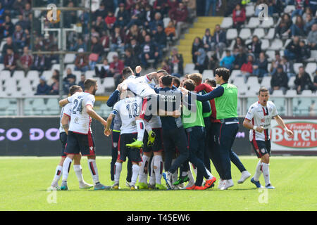 Turin, Italy. 14th Apr, 2019.  Serie A football, Torino versus Cagliari; Cagliari players celebrate after the referee has awarded their goal in the 75th minute Credit: Action Plus Sports Images/Alamy Live News - Stock Image