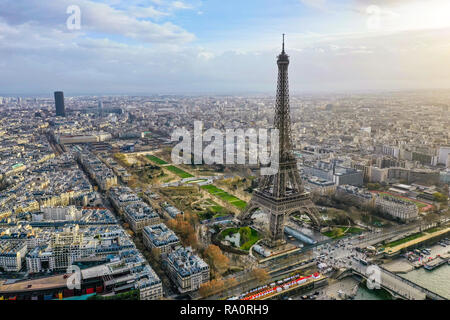Beautiful Paris Aerial Panoramic Cityscape View feat. Famous Iconic Landmark Eiffel Tower, Champ de Mars Park, Seine River in France - Stock Image
