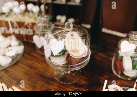 Desserts in cake stand during wedding - Stock Image