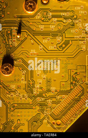 Close-up of gold and white computer circuit board details, Studio Composition, Quebec, Canada - Stock Image