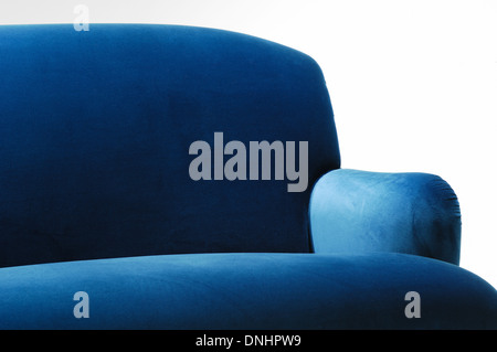A section of a comfortable blue suede sofa couch furniture. - Stock Image