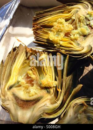 Roasted artichoke with garlic & butter. - Stock Image