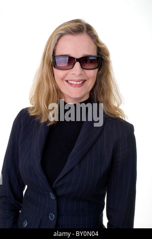 Smiling European business women in her 40's wearing sunglasses isolated on white - Stock Image
