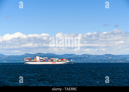 A cargo ship in the Strait of Juan de Fuca between Victoria, British Columbia and Port Angeles, Washington State - Stock Image