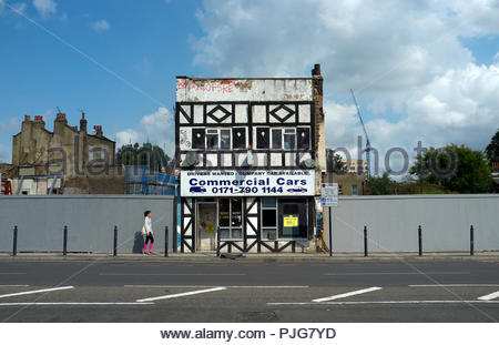 Commercial Cars - isolated taxi office building amongst future development at 617 Commercial Road, east London (E14 7NT), UK. - Stock Image