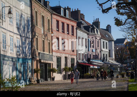 Tourists stroll in the Winter sun in Honfleur, France - Stock Image
