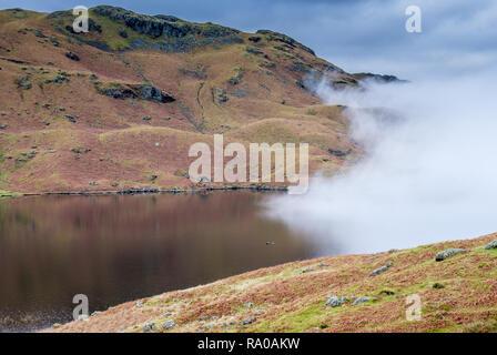 Mist encroaching upon Easedale Tarn, Grasmere, Lake District, Cumbria - Stock Image