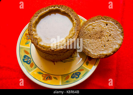 Mushroom soup, served inside dark rye bread bowl, restaurant, Pilies gatve, old town, Vilnius, Lithuania - Stock Image