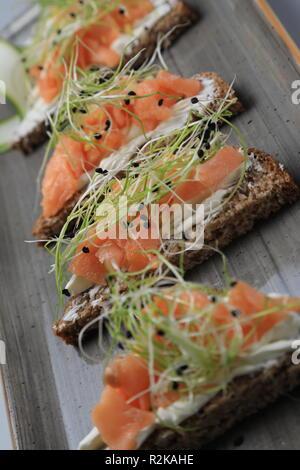 Set of salmon on cream cheese sandwiches - Stock Image
