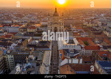 Budapest, Hungary - Sunrise over Budapest on an aerial drone shot with St. Stephen's Basilica and Zrinyi street - Stock Image