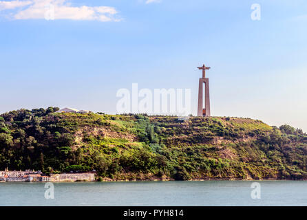 Christ the redeemer statue on the banks of the Tagus river, Lisbon Portugal - Stock Image